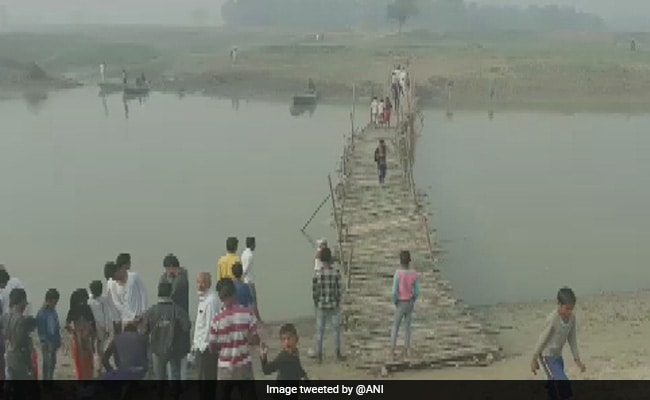 Watch: Locals Make Temporary Bridge To Help Voters Reach Polling Station In Bihar