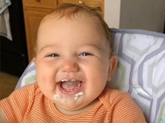 Viral: Adorable Baby Can't Stop Laughing While Eating Cream; The Video Will Leave You In Splits