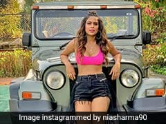 Nia Sharma ने जिप्सी के आगे अलग-अलग जूतों में यूं दिया पोज, एक्ट्रेस का अंदाज हुआ वायरल- देखें Photos