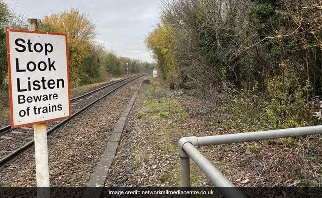 Hair-Raising Video Shows Jogger Nearly Getting Hit By Train