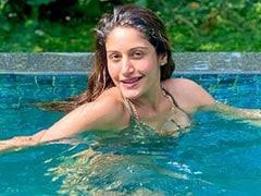 टीवी की 'नागिन' सुरभि चंदना ने स्विमिंग पूल में कराया फोटोशूट, यूं पोज देती आईं नजर- देखें Photos