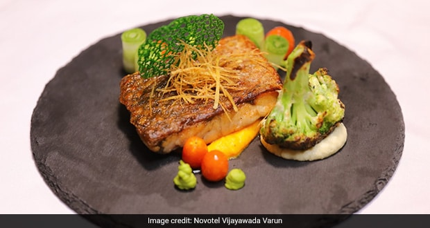 Sea Bass With Cauliflower Smoked Cream And Tandoori Broccoli