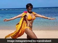 Mandira Bedi Sets Our Screens On Fire In A Yellow Bikini Set