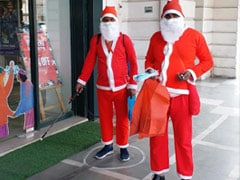 Santa Claus Gifts Masks, Sanitises Delhi Market For Christmas