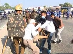 Video: Cops Climb Tractors, Snatch Keys In Clash With Farmers On Highway