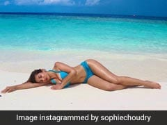 Sophie Choudry In A Blue Bikini Is Making Waves As A Stunning Mermaid