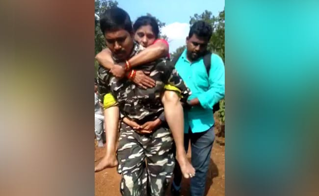 On-Duty Cop At Tirumala Carries Woman On Back For Medical Aid, Wins Hearts