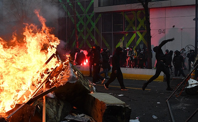 Protesters Clash With Police, Set Cars On Fire Over New Security Law In Paris