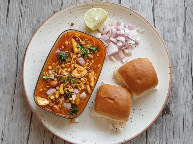 try this amazing spicy tangy misal pav recipe at home recipe video inside