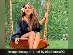 निया शर्मा ने ब्लैक आउटफिट में ग्लैमरस अंदाज में कराया फोटोशूट, देखें Photos