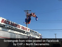Video: Parachuting Santa Claus Gets Tangled In Power Lines