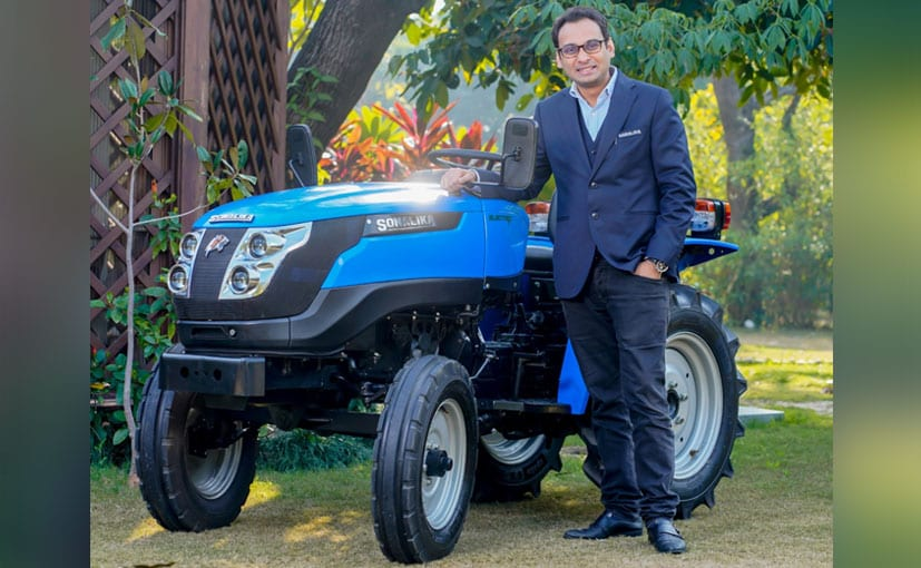 Raman Mittal, executive director, Sonalika Group with the Tiger Electric tractor