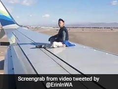 Man Climbs Airplane Wing Right Before Takeoff In Bizarre Video