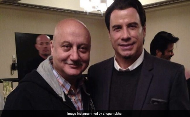 Just A Pic Of John Travolta With Anupam Kher. Can You Spot Anil Kapoor In The Background?