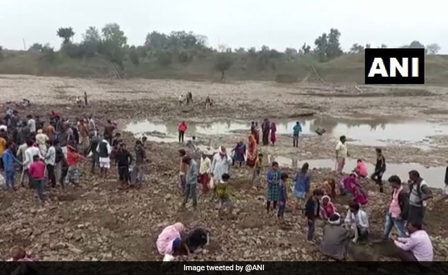 People Gather To Dig Madhya Pradesh Riverbed In Hope Of Finding Old Coins