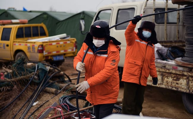 Rescuers say at least two more weeks to free Chinese miners
