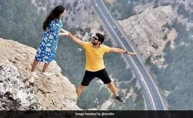 Couple Poses On Cliff's Edge In Viral Pic That Has People Baffled