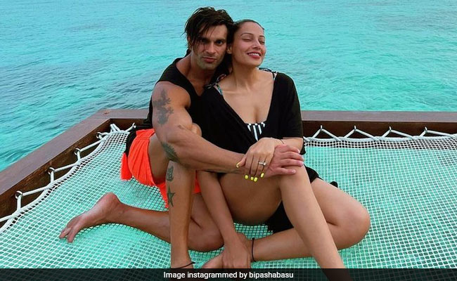 Karan Singh Grover cuts this tropical birthday cake with his wife Bipasha in the Maldives