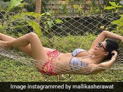 Mallika Sherawat In A Printed Bikini Takes Us Back To Palm Trees And Wild Nature