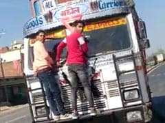 Watch: Madhya Pradesh Man Keeps Speeding As 2 Hold On To Truck Front