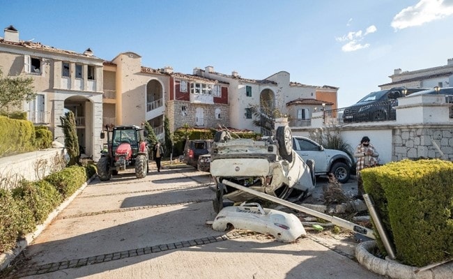 Twister Throws Vehicles Into Air, Rips Aside Buildings