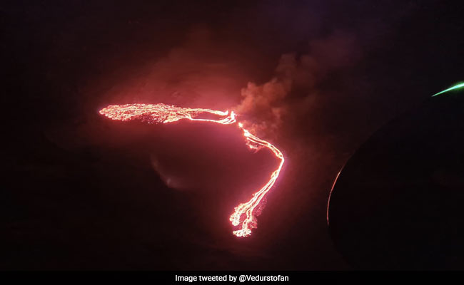 Fountains of lava flow from erupting volcano in Iceland