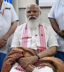 PM Modi's Vaccination With Symbols Of State Polls: Pics
