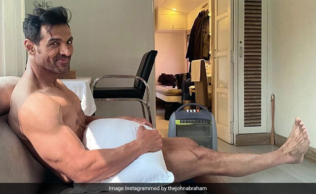 Just A Pic Of John Abraham 'Waiting For Wardrobe.' We Can't Even...
