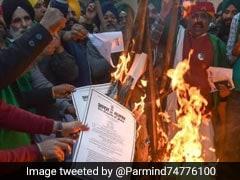 "Farmers Burn Copies Of Farm Laws At Delhi Border To Celebrate ""<i>Holika Dahan</i>"""