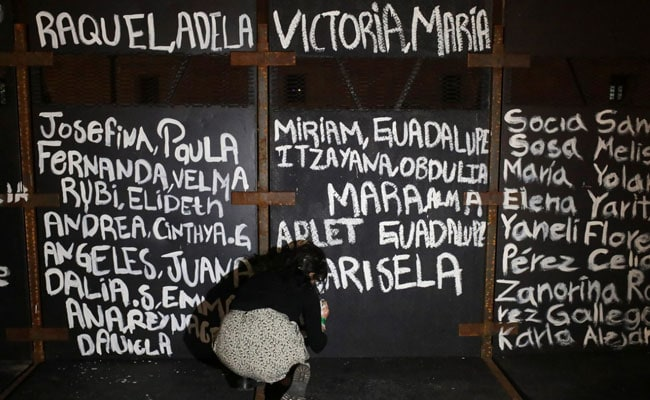 'Victims Of Femicide': Mexico Activists Paint Woman Violence Victims' Names On Barriers