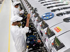 PM Modi's 'Self-Reliant India' Attracts Apple, Amazon, Tesla
