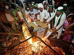 Farmers Burn Copies Of Farm Laws To Mark 'Holika Dahan' Day Before Holi