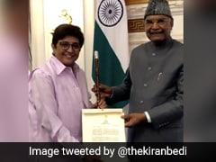 President Kovind Presents Baton Of Honor To Ex-Puducherry LG Kiran Bedi