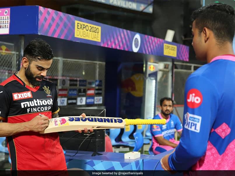 "IPL 2021, RCB vs RR: Virat Kohli Fulfils Riyan Parags ""Fan-Boy Moment"", Sign His Bat After Match. See Pic"