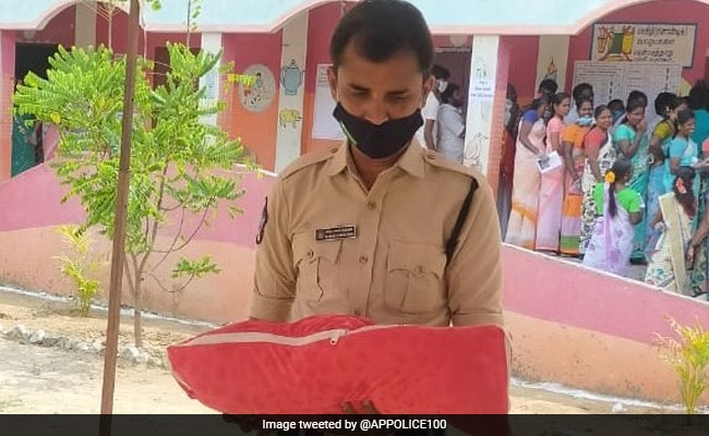 Cop Comforts Crying Baby While Mother Casts Vote In Tamil Nadu. Viral Pic Wins Hearts