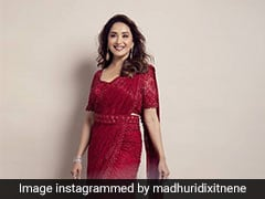 We Cherry-Ish Madhuri Dixit's Timeless Grace And Style In Her Ravishing Red <i>Saree</i>