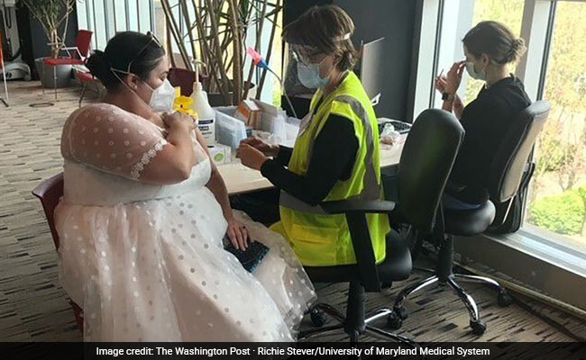 She Couldn't Wear Her Wedding Dress Amid Covid. So Wore It To Get Vaccine