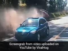 Watch: Dangerous Overtaking Maneuver Sends Truck Crashing Into Ditch