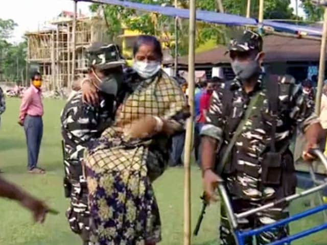 Watch: Security Personnel Assist Woman Get To Polling Booth In Bengal