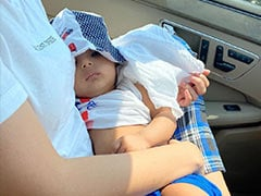 """Just A Pic Of Amrita Rao And RJ Anmol's Baby Son Veer """"Keeping A Close Check"""" On His Dad's Driving"""