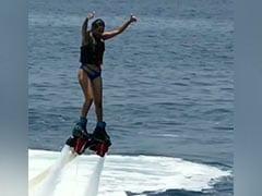 Nia Sharma ले रही थीं फ्लाइंगबोर्ड का मजा, तभी बिगड़ा बैलेंस और गिर पड़ी पानी में- देखें Video