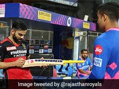 "IPL 2021, RCB vs RR: Virat Kohli Fulfils Riyan Parag's ""Fan-Boy Moment"", Sign His Bat After Match. See Pic"