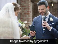 Bride And Groom Exchange NFT Rings During Wedding