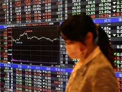 Asian Shares Give Up Early Gains As New Covid Cases Rise