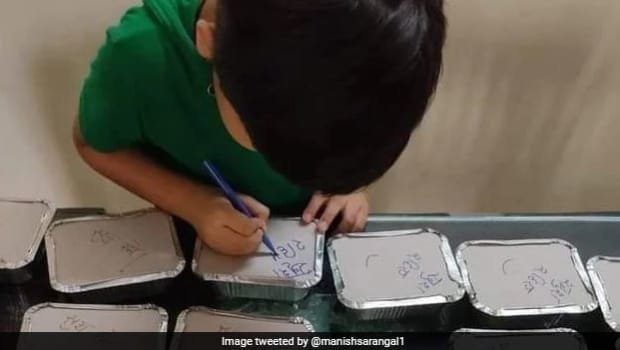 Boy Writes Special Messages On Meal Boxes Made By Mother For Covid Patients, Wins Internet