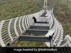 Man Left Dangling From 330-Foot Glass Bridge As Strong Winds Shatter Panels