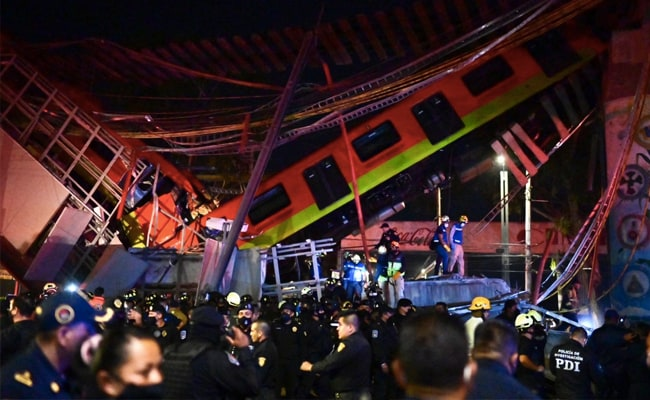 At least 15 dead after Mexico City metro overpass collapses on road