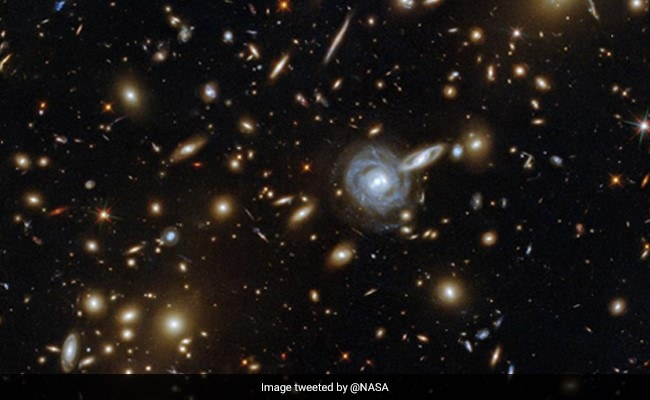 'Time To Peer Into The Universe': NASA's Stunning Image Of Galaxy Cluster