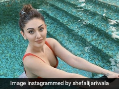 Shefali Jariwala Beats The Summer Heat In Style In A Chic Red Striped Bikini
