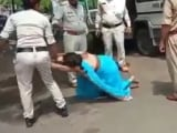 Video : Video: Woman Thrashed By Madhya Pradesh Cops In Front Of Daughter Over Mask